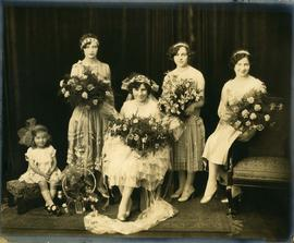[Bride with bridesmaids and flower girl]