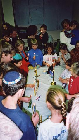Hanukah [- children lighting menorahs]