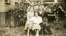 Esther Nemetz and Ben Dayson [seated in a garden with Florence Nemetz? and Bill Nemetz?]
