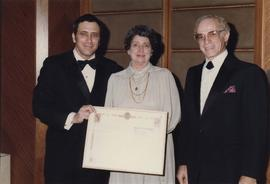 Unidentified woman receives certificate from Jewish National Fund