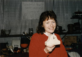 Carla Cooper showing clock for sale, Hadassah Bazaar, P.N.E.