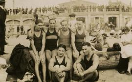 [Irving Snider with friends at English Bay in front of the old bathhouse]