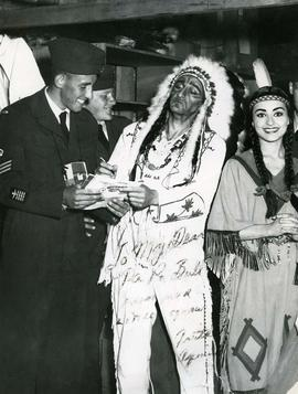 Ben as Chief Sitting Bull signing an autograph for a R.C.A.F. personnel