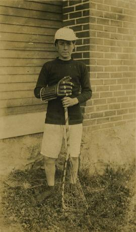 Unidentified boy holding a lacrosse stick