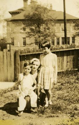 [Esther Dayson with two unidentified children]