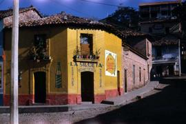 "Yellow building with ""La Silueta, Boneteria, Rodriguez"" painted around the front door"