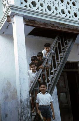 Children standing in a stairway