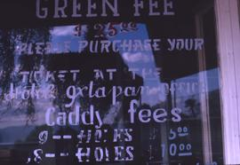 Golf course fees sign