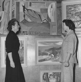 Two women viewing artwork