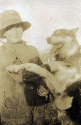 [Young Irving Snider and dog]