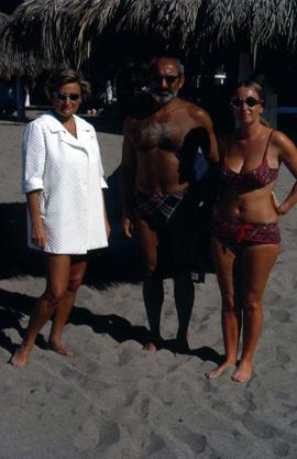 Phyliss Snider and an unknown man and woman wearing beachwear