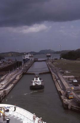Boat going through the Panama Canal taken from another ship in the foreground