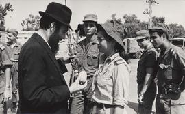 A Lubavitch youth instructs Israeli soldiers in the performance of the 'lulav' and &#03...