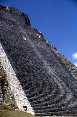 Side angle shot of a Mayan pyramid, likely the Uxmal Pyramid of the Magician