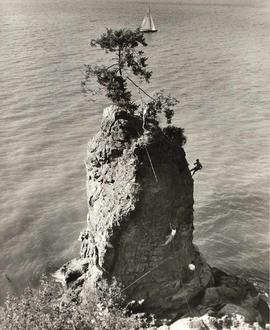 Climbers on Siwash Rock, Stanley Park, Vancouver, British Columbia