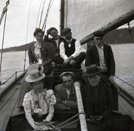 [Unidentified people, likely members of the Sylvester family, on a boat]