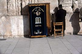 Blue cloth with Hebrew writing, hanging in front of the Western Wall]