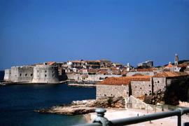 Stone houses and the St. John Fortress, part of Dubrovnik's city walls, farther away
