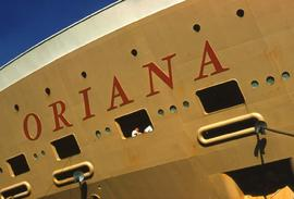 "Yellow ship with ""Oriana"" painted on the side"