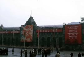 Red Square with people and propaganda banners on the GUM building