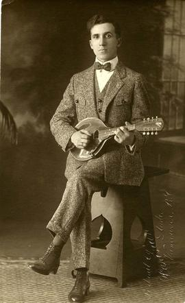 Baryl Victor [posing with guitar]