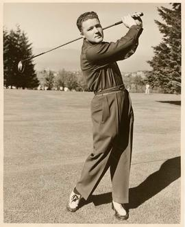 Golfer Kenneth Black, swinging his golf club