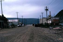Street in Dawson City with the river and mountains in the background