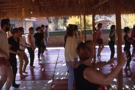 Group of people taking a dance lesson