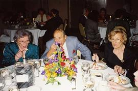 [Esther Dayson, Ben Dayson and Phyliss Snider eating at an unknown event]