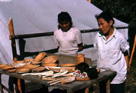 Two unidentified women selling locally made crafts and souvenirs
