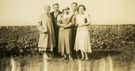 [Group of people posing in a field]