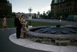 Phyliss Snider and Harry Nemetz posing by the Centennial flame