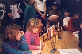 [Group of children around menorahs]