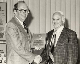 Lou Zimmerman, Jewish Community Council, and Dick Kavanagh holding a United Way plaque