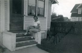 Miriam sitting on front stoop