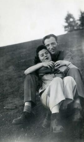 Photograph of [Ann + Murray Letcher] seated on grass
