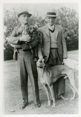 Photograph of [Charlie Hanson] with unidentified person and dogs